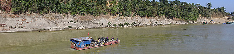Our land rover Defender on a boat, upstream on the Chindwin river