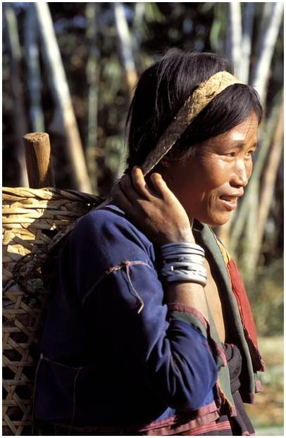 Pao woman in the north Shan state with silver bracelets and belt.