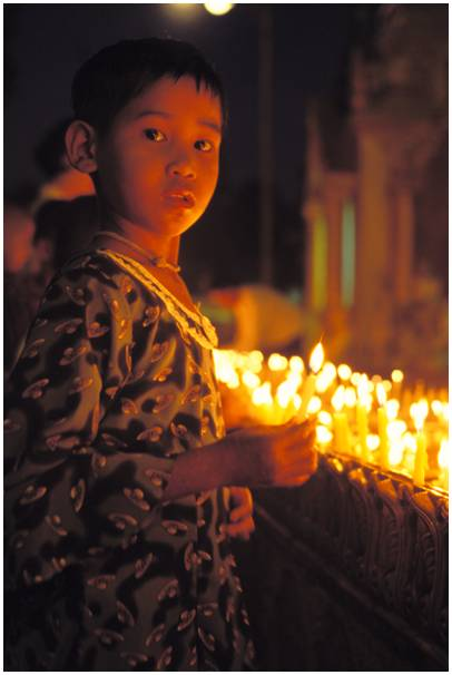 child with a candle