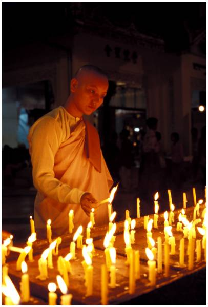 Light festival,  Nun with a candle, Shwedagon pagoda, Yangon