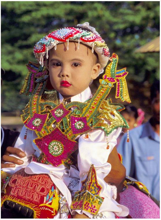 child dressed for entry at a monastery, novice ceremony